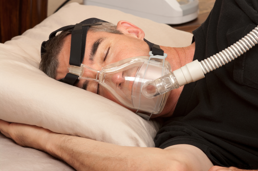 Man using oral appliance machine for sleep apnea from Dr. Kurt Gibson, DDS, Winston-Salem, NC
