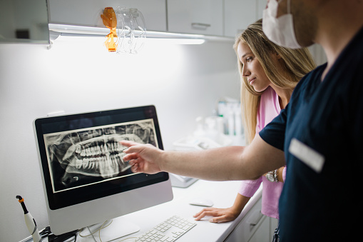 Doctor showing patient digital x-rays on computer screen at Dr. Kurt Gibson, DDS, Winston-Salem, NC